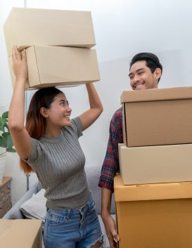 Asian young couple carrying big cardboard box for moving in new house, Moving and House