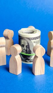 Figures of people surround a bundle of money